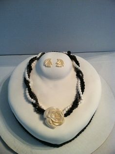 Necklace Cake - A necklace bust decorated with a multi stand fondant pearl necklace  with a rose pendant and leaf shaped earrings.