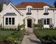 Mid sized traditional exterior home with brown roofs and white wall gray windows doors arched front doors big glass windows exposed stone mortar of Charming Exterior Paint Colors with Brown Roof Ideas for House Remodeling Exterior Paint Colors For House, Paint Colors For Home, Exterior Colors, Exterior Design, Paint Colours, Stucco Colors, Shingle Colors, Red Roof House, House Siding