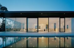 Modernism is at its best with this living space. Limestone, concrete, glass and steel provide a complimentary contrast to the landscape while it sits atop the beautiful Swedish rock outcrop. The architect John Robert Nilsson designed the home to look West to maximize the amount of light inside throughout the day.    The infinity edge pool and hot tub fit so smoothly into the concrete at the foundation's edge without hindering the rest of the design. Some parts of the house that aren't in…