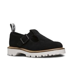 The classic Dr. Martens Polley T-bar - our take on the Mary Jane silhouette - gets fresh in ridiculously soft black nubuck suede with a contrasting, chunky white sole.With one buckled strap, the women's shoe still retains all the classic Doc's DNA, like grooved sides, stitching and our iconic, durable air-cushioned sole.