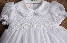 Google Image Result for http://www.mysmockeddress.com/wp-content/uploads/2009/08/Smocked-Christening-Dress-Willbeth.jpg