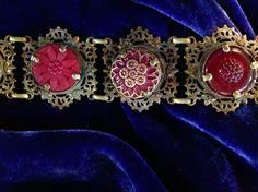 Vintage buttons set in brass filigree