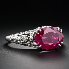 A fabulous Edwardian-era ring featuring a luscious deep bright red oval no-heat Burmese Ruby with consummate neo-classical design. circa 1915