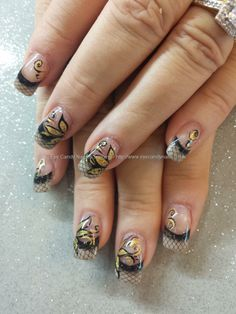 Black and gold freehand nail art with netting