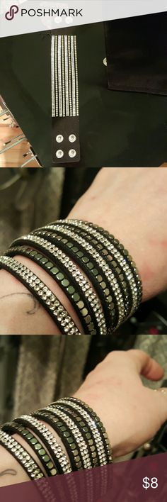 Did u say BLING , wrap bracelet This is a black base with layers and rows of bling. Adjustable snap closure.9 in long but gets smallet. Lead and nickel free. paparazzi Jewelry Bracelets