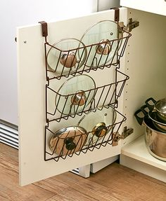 Store all of your lids in one place with this Cabinet Lid Organizer. Perfect for pot lids, container lids and more, this organizer hangs from the inside of a ca