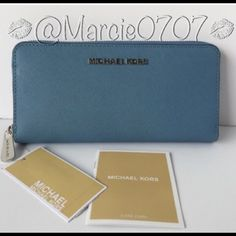 Micheal Kors wallet Micheal Kors wallet in sky za continental leather. With silver accentsBrand new. Michael Kors Bags Wallets