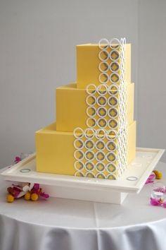 Modern yellow, white, and gray wedding cake.
