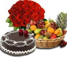 A Hamper of 2 kg Fresh Fruits with 1/2Kg flavored cake and 12 red roses.