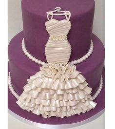Bridal gown with pearls cake simple ruffles give a great effect.  #cakedecoratingcourses #weddingcakes #decoratingcakes