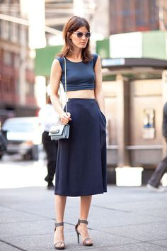 Hanneli Mustaparta, in stylish chic cropped top & midi skirt with shoulder bag & single strap sandals