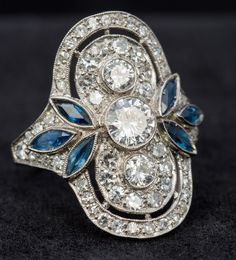 An Art Deco diamond and sapphire set platinum up-and-down the finger ring The central stone appro Art Deco Jewelry, I Love Jewelry, Jewelry Box, Jewelery, Antique Jewelry, Vintage Jewelry, Lipstick Case, Art Deco Diamond, Blue Rings