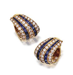 PAIR OF SAPPHIRE AND DIAMOND EARCLIPS, VAN CLEEF & ARPELS, PARIS.  The half hoops set with 62 round diamonds arranged in three rows, weighing approximately 4.00 carats, spaced by rows of calibré-cut sapphires, mounted in 18 karat gold, signed Van Cleef & Arpels, numbered M38143, make's mark, assay marks. En suite with lot 310.