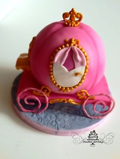 Cake for little princess. Pink carriage for Cinderella.