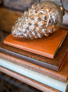 These leather-wrapped books only *look* like antiques. See how Camille made her own vintage-style accents. (http://blog.hgtv.com/design/2013/11/14/home-for-the-holidays-how-to-make-leather-wrapped-books/?soc=pinterest-blogparty)