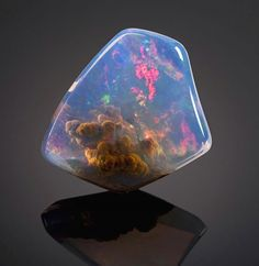 "Luz Opal with ""The Galaxy"" inside ~ At first glance, it looks like something from a sci-fi films - an entire nebula trapped inside a stone. However, in fact the incredible object is an opal, found in Oregon. It was sold by auction house Bonhams for $20,000, described as 'suitable for mounting as a stunning and unique pendant.'"