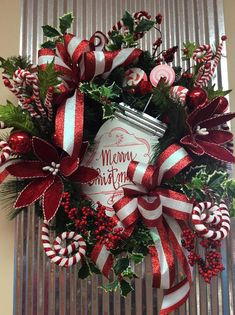 Decorate your door with this beautiful, red and white Christmas door wreath. This large wreath is full of color and would be a great wreath to use inside or outside the home. The size of this wreath decorated is around 26 x 27. I ship FAST, Find more of my Christmas listings at