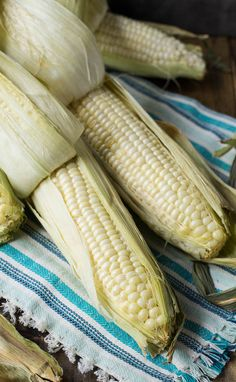 Roasted Corn- roasting corn in the oven with the husks on results in the most flavorful corn. Plus the husks and silk come off super easy after it is cooked.