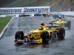 Damon Hill leads Ralf Schumacher as the Jordan team head towards their first win at the Belgian Grand Prix in 1998.