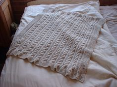 Cabled baby blanket by Go Suzy Go, via Flickr