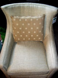 Tan chair with accent pillow