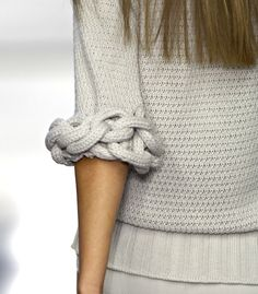 Sleeve detail - grey sweater with chunky chain, knitted cuff - knitwear closeup; cool fashion design details