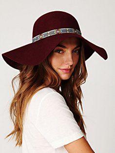 maroon floppy felt hat. slightly obsessed.