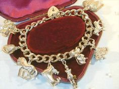 Hey, I found this really awesome Etsy listing at https://www.etsy.com/listing/199190380/vintage-silver-charm-bracelet-and-nine