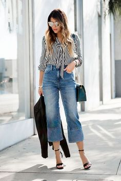blue high waisted cropped jeans, a striped shirt, black heels and a teal bag