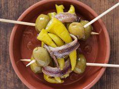 Gildas are a simple assembly of anchovy, olives, and chili peppers.