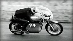 Hailwood® racing at full speed at Silverstone in 1960, again on the Ducati 250 Desmo.