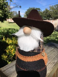This cowboy gnome is dressed in his western gear , including cowboy hat, plaid shirt and holsters. Great gift for collectors or for any western decor Cowboy Crafts, Western Crafts, Western Decor, Cowboy Christmas, Christmas Gnome, Brown Cowboy Hat, Creative Crafts, Diy Crafts, Fabric Dolls