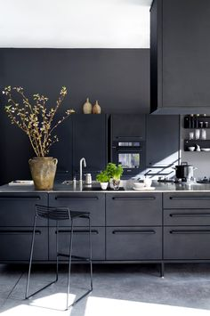 Black kitchen, black walls.