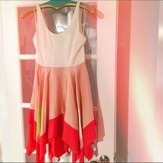 Alice & Olivia asymmetrical dress Very lightweight summer dress. Cotton top with silk asymmetrical skirt. Barely worn. Has belt loops but belt not included. Alice + Olivia Dresses Asymmetrical
