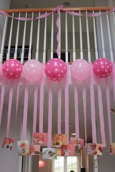 Streamers with pictures of your one-year-old attached and polka dot balloons is a great way to decorate for the party. See more first girl birthday and party ideas at www.one-stop-party-ideas.com