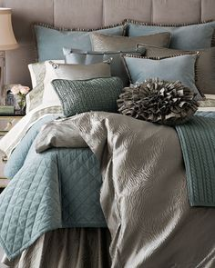 I'm finding that I'm increasingly torn between a comforter/duvet and this style of quilted bedspread/coverlet. The bedspread may win out yet. I also like the color combo here.