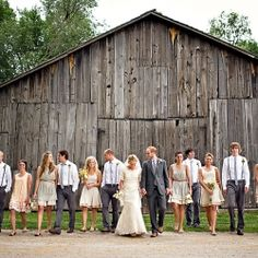 love this wedding party picture and the mismatched bridesmaid dresses.