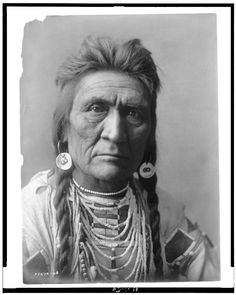 Wolf  1 photographic print. | Head-and-shoulders portrait of Crow man.  Contributor:Curtis, Edward S. Original Format:Photos, Prints, Drawings Date:1908