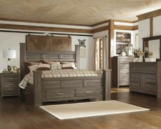 Our new KING sized bed and night stands! Juararo Poster Storage Bedroom Set