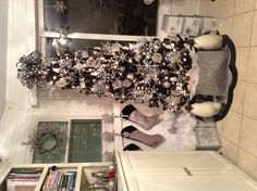 Loving for this year black Christmas tree.. White, silver & pink accents w/ crystals