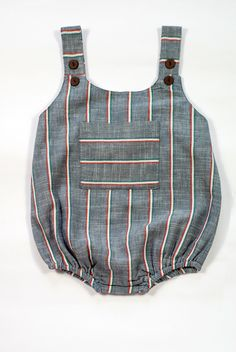 This cute romper in a very hardy handwoven cotton is fully lined for extra softness. The straps have 2 buttons for adjusting length. Wear it as is or layer it with a tee. Hand wash or machine wash gen