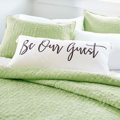 They vote you one of the nicest hosts ever when they see your  Our Guest Pillow. In modern black calligraphy script, the friendly    saying welcomes everyone. This oversized pillow even has tassels on each of the four corners. The zip-closure cover of this pillow is made of off-white    cotton canvas, front and back. A soft feather filling adds comfort. Zip closure. Spot clean. Imported.            Oversized pillow with  Our Guest wording on one side                Off-white cotton canvas...