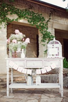 style me pretty - real wedding - usa - texas - austin wedding - lady bird johnson wildflower center - reception decor - table decor - centerpiece - roses & baby's breath