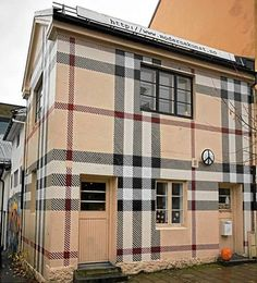 '...Once a symbol for all things chav, Burberry had successfully re-branded itself as one of the UK's most sophisticated fashion labels. But a Norwegian artist looks set to undo all of their hard work after painting the exterior of his house – a former public toilet – in the brand's signature check. Jens Werner, 33, covered the entire building in the famous beige, black and red tartan design. The re-painting of the building in Larvik took several weeks at a cost of thousands of dollars...'