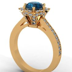14k Yellow Gold Diamond Engagement Ring with Blue Topaz Center  -Style 15Y14DBT. $1,950.00, via Etsy.