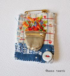 brooch  flattened thimble as the pot    Sweet!