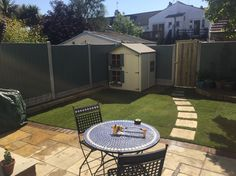 Woodfield Road: honeymede patio,Chialey paver edge, wooden planters and Rolawn turfing designed and constructed by #jamesdaltonlandscaping