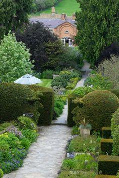 Whimsical hedges!  Classic English shrub & perennial borders.  Cotswold House Hotel & Spa, Gloucestershire, United Kingdom.