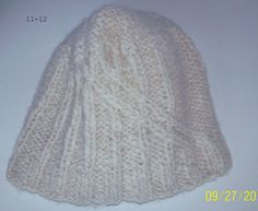 Hand Knitted cap, hand carded and handspun Alpaca fiber. $25.00, via Etsy.