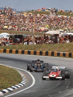 Jacky Ickx slides his Ferrari 312B2 ahead of Emerson Fittipaldi's Lotus 72D at the Brazilian Grand Prix, 1977.